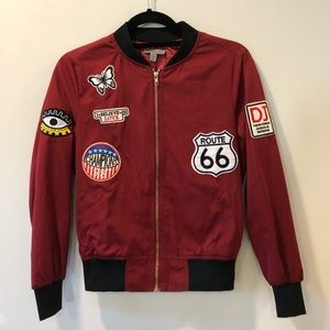 Maroon bomber jacket with patches